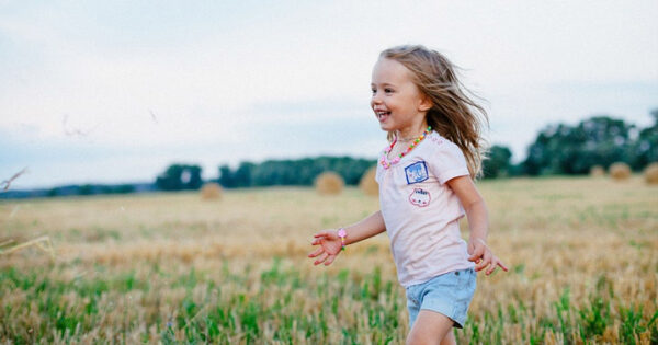 child playing in field