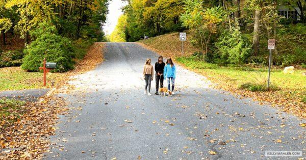 girls walking a dog